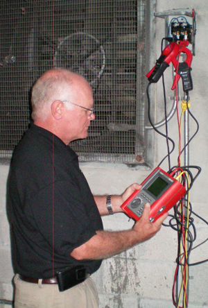 Clem Janes President Bill Dalton verifies a large fan power usage with a Amprobe digital data recorder